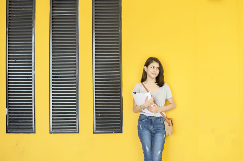 student-yellow-wall